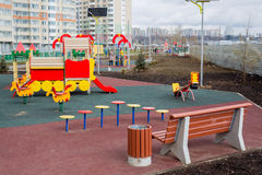 Children's playground in the courtyard of an apartment house with solar panels Royalty Free Stock Photo