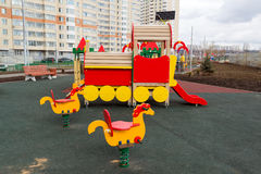 Children's playground in the courtyard of an apartment house with solar panels Royalty Free Stock Image