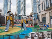 Children`s playground in the courtyard of a residential area stock photos
