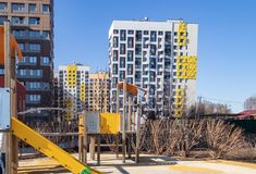 Children`s Playground in the courtyard of the residential area on a Sunny spring day. Housing complex `In the forest`, Moscow, stock image