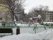 Children`s playground. Covered in snow stock photography