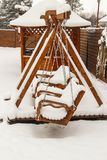 Children`s playground covered with snow. In winter Stock Photo