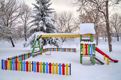 Children`s playground covered with snow Stock Photo