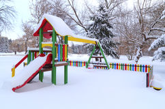 Children`s playground covered with snow Royalty Free Stock Images