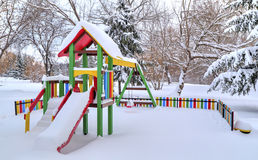 Children`s playground covered with snow Royalty Free Stock Photography