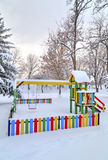 Children`s playground covered with snow Royalty Free Stock Image