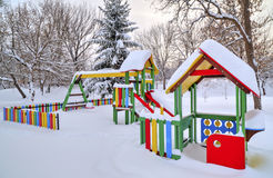 Children`s playground covered with snow Stock Images