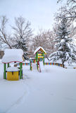 Children`s playground covered with snow Stock Photos