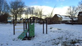 Children`s Playground Covered in Snow During Winter. Kids playground covered in snow during winter.n Stock Photography