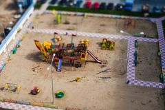 Children`s playground with different types of swings. Tilt-shift photo stock photo