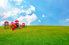 Children's playground in garden Royalty Free Stock Photos