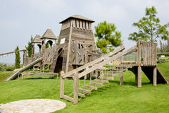 Children's Playground made from wood in park Stock Image