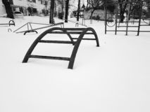 Childrens playground near the house in winter. In the snow royalty free stock images