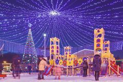Children`s playground in the New Year`s decorations on the town stock images