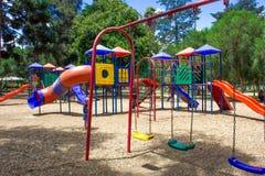 Children`s playground in the park. stock photos