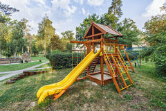 A children's playground in the park with a slide Stock Photos