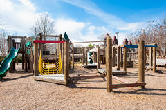 Children's playground with play structure. Children's park with wooden play structure playground with slide Stock Photos
