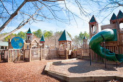 Children's playground with play structure. Children's park with wooden play structure playground with slide Royalty Free Stock Photo