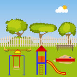 Children`s playground with a sandbox and swings Royalty Free Stock Image