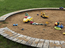 Children`s playground with sandbox and toys, relaxation park. Familie place. Children`s playground with sandbox and toys. Relaxation park, leisure place for Royalty Free Stock Images