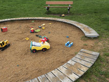 Children`s playground with sandbox and toys, relaxation park. Familie place. Children`s playground with sandbox and toys. Relaxation park, leisure place for Stock Photography