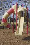 Children's playground slide. A single slide on children's playground equipment at the park Royalty Free Stock Image