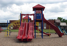 Children's Playground Slide. Several different designs and kinds of slides in this children's playground Royalty Free Stock Images