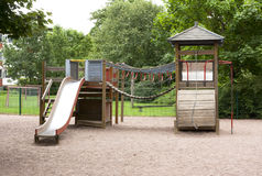 Children's playground with slide, climbing frame and rocking. At summer Stock Image