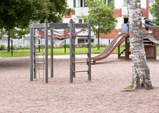 Children's playground with slide, climbing frame and rocking. At summer Royalty Free Stock Photos