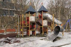 Children`s playground with slide outdoors winter season. On cloudy day Royalty Free Stock Images