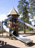 A children's playground with a slide. At summer day Royalty Free Stock Photo