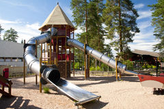 A children's playground with a slide. At summer day Stock Photography