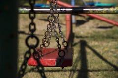 Children`s playground swing perspective shot stock photo