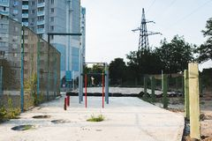 Children`s playground with swings in courtyard of residential building in the city stock images
