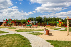 Children's playground with swings and slides countryside Royalty Free Stock Photo