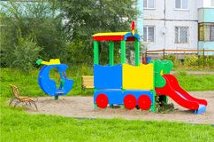 Children`s playground in the usual courtyard of an apartment building. provincial town. summer. Russia royalty free stock photo