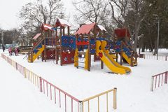 Children`s playground in the winter in the park named after Leni. Evpatoria, Crimea, Russia - February 28, 2018: Children`s playground in the winter in the park Stock Images