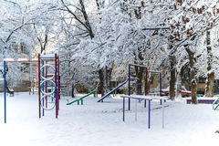 Children`s Playground in winter. The snow-covered empty Playground Royalty Free Stock Images