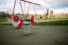 Children`s playground with fish rider stock photography