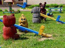 Children's playground with wooden swings Royalty Free Stock Image
