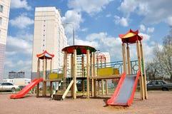 Children's playground in  yard Stock Photo