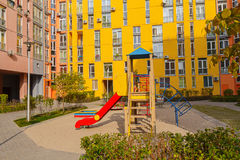 Children's playground in the yard colorful houses Stock Photography