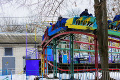 Children`s playgrounds and children`s rides in the winter. On a holiday Maslenitsa Royalty Free Stock Photos