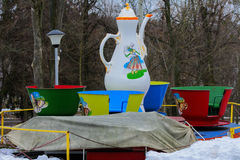 Children`s playgrounds and children`s rides in the winter. On a holiday Maslenitsa Stock Images