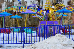 Children`s playgrounds and children`s rides in the winter. On a holiday Maslenitsa Stock Image