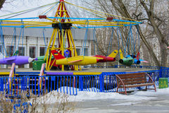 Children`s playgrounds and children`s rides in the winter. On a holiday Maslenitsa Stock Photography