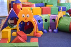 Children`s playroom. The interior of the children`s playroom with toys. Kindergarten stock image