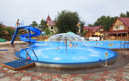 Children's pool with a fountain and a slide. Stock Photos