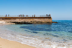 Children`s Pool in La Jolla With People on Sea Wall Royalty Free Stock Image
