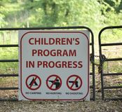 Children`s Program Sign. Children`s Program and learning center in Progress, No Camping, No Hunting, No Shooting stock images